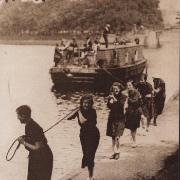 Girls pulling a boat