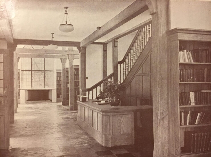 Interior of JR Memorial Library. Reception desk with wooden fixtures and furnishings in the Arts and Crafts tradition.